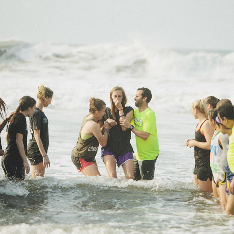Student is baptised in waters of the Pacific Ocean in El Salvador.