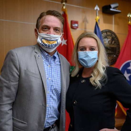 Lisa Piercey and Mark Ezell wearing masks.