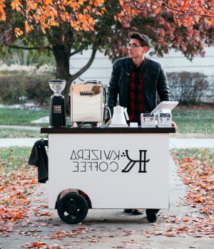 Student Aidan Miller with his kwizera咖啡 cart