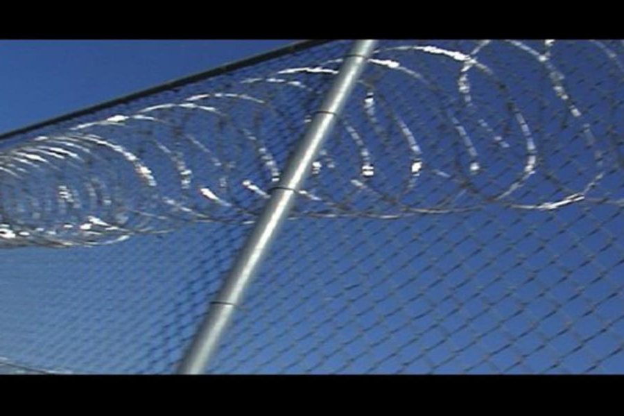 Prison fence and barbed wire