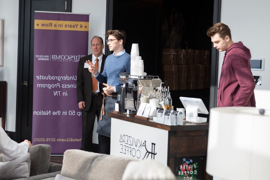 Aidan Miller with his coffee cart at an event