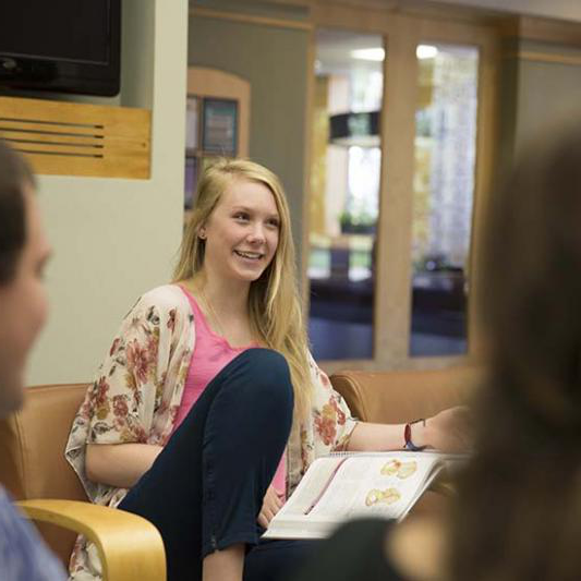 Student talks with others in Bennett Campus Center